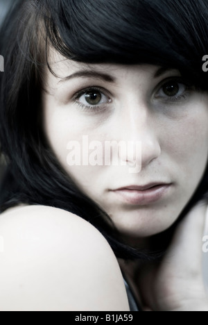 seriously looking young woman - Stock Photo