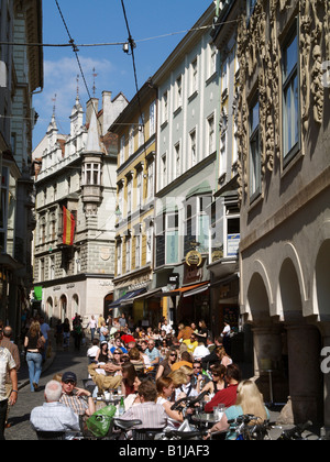 people sitting in cafs in an alley of the oldtown of Graz, Austria, Graz - Stock Photo