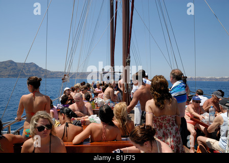 Tourists on the deck of a sailing ship in Greece - Stock Photo