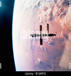 International Space Station in orbit around the Earth Above The Sahara Desert - Stock Photo