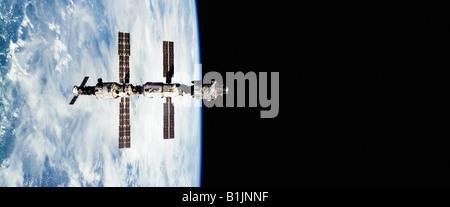 International Space Station orbiting the Earth - Stock Photo