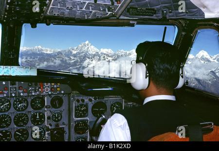 Nepal pilot of plane flying through Himalayas towards Mount Everest - Stock Photo
