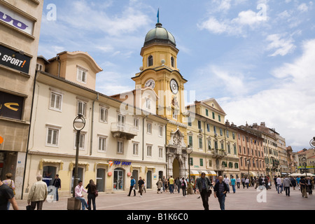 Civic Tower clock gateway in pedestrianised Korzo Street with people in city shopping district. Rijeka Istria Croatia - Stock Photo