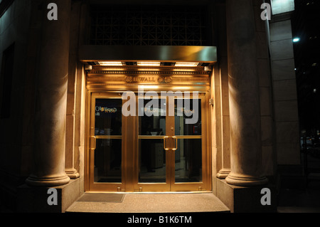 The Wall Street entrance to the New York Stock Exchange. - Stock Photo