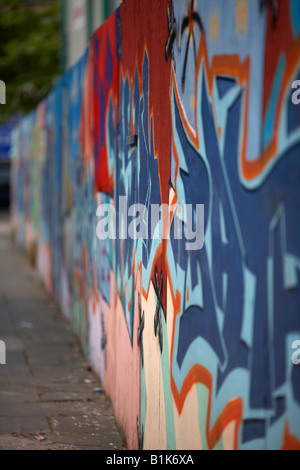 wall of graffiti tag art painted on wooden hoarding in belfast city centre northern ireland