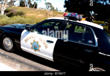 Highway Patrol Car on Freeway California - Stock Photo