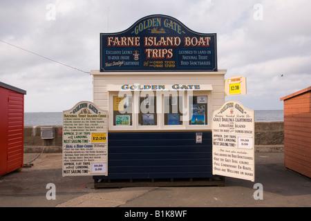 Boat trip kiosks Seahouses Northumbria England - Stock Photo