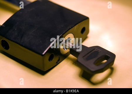A padlock and key for security and lock up possesions - Stock Photo