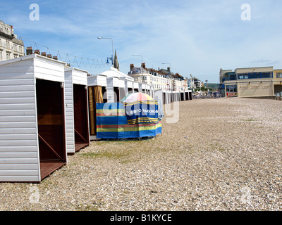 Do it yourself beach huts on the shingle beach at weymouth,dorset,uk. - Stock Photo