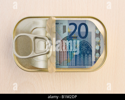 Plan view of a Ring Pull Tin containing 20 Euros on wooden surface - Stock Photo