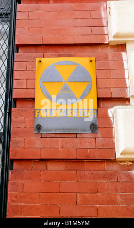 A Fallout Shelter sign circa 1963 still on the side of a building - Stock Photo
