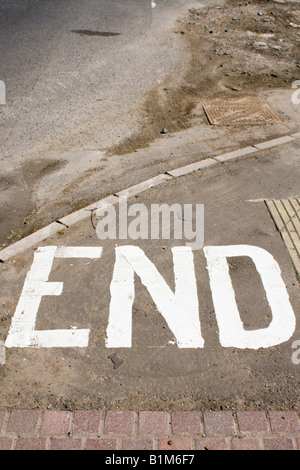 End printed on a pavement - Stock Photo