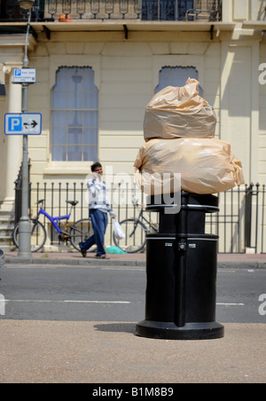 Bags of rubbish sit on top of a Brighton rubbish bin ready for collection. Picture by Jim Holden. - Stock Photo