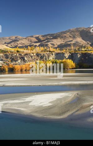 Siltation in Lake Dunstan and Autumn Colours Bannockburn Central Otago South Island New Zealand - Stock Photo