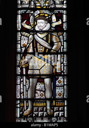 Stained Glass Window showing Edmund Slyfield Wearing a Dublet and Hose Saint Nicholas Church Great Bookham Surrey - Stock Photo