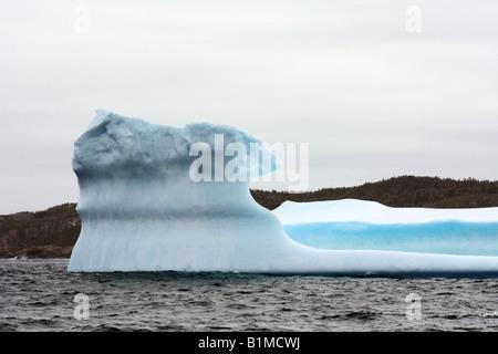 Giant iceberg at Witness Bay in Atlantic ocean near Newfoundland - Stock Photo