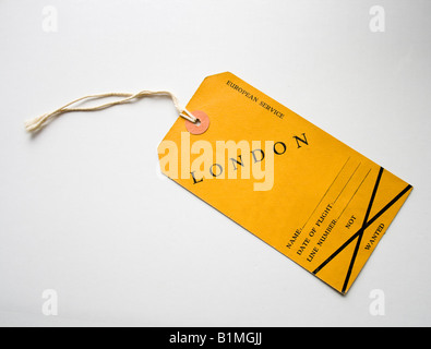 vintage yellow luggage label for flight to London in 1948 - Stock Photo