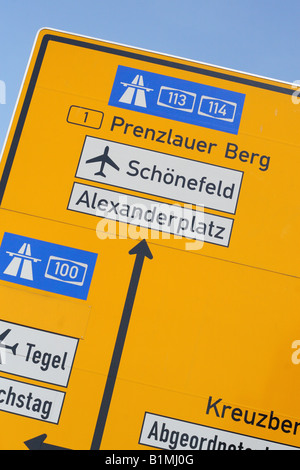Berlin Germany road traffic sign showing direction route to Schonefeld airport Alexanderplatz and Prenzlauer Berg - Stock Photo