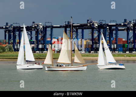 Sailing boats on the river Orwell near the Port of Felixstowe, Suffolk, UK. - Stock Photo