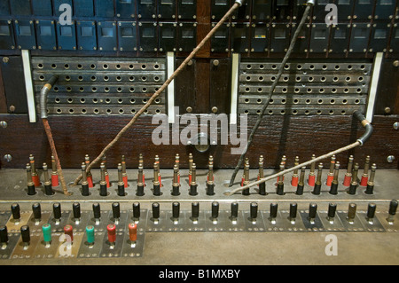 Old telephone switchboard with cables - Stock Photo