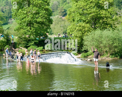 People enjoying a sunny day on the River Avon at Claverton Weir, Bath UK - Stock Photo