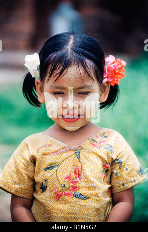Myanmar Burma Bagan Young Girl Smiling With Traditional Face Markings Made Of Thanaka Tree Paste - Stock Photo