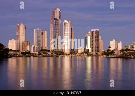 Low angle view of Surfers paradise skyline at dusk across nerang river - Stock Photo