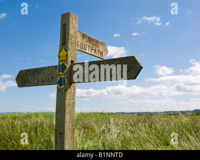 Wooden signpost indicating public footpaths and bridleways in the Marshlands, East Yorkshire, England, UK - Stock Photo