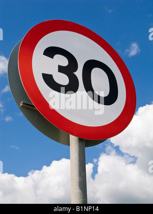 30mph speed limit road sign England UK isolated against a blue sky - Stock Photo