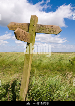 Wooden footpath direction sign post indicating public footpaths and bridleways in the Marshlands, East Yorkshire, - Stock Photo