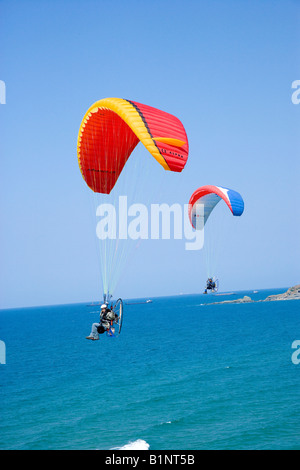 Two powered paragliders flying above the Black Sea coast of Istanbul aerial view Turkey - Stock Photo