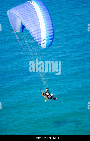 Powered paraglider flying above the Black Sea coast of Istanbul aerial view Turkey - Stock Photo
