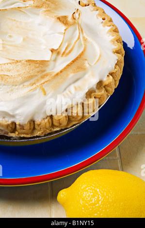 Lemon meringue pie with lemon - Stock Photo