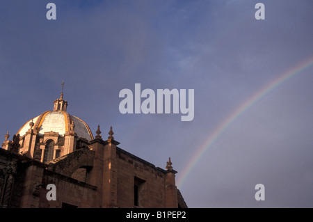 Rainbow over the dome of the Ex-Templo de San Agustin Church, Zacatecas, Mexico - Stock Photo