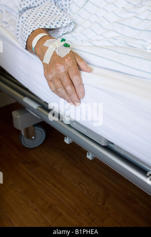 Sick senior shortly before his operation in the hospital bed for private insurance patients of the category 1st - Stock Photo