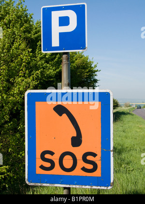 Parking and SOS signs on A road, England - Stock Photo