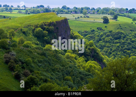 Thor's Cave in the Manifold Valley of the limestone White Peak in Staffordshire England in the Peak District National - Stock Photo