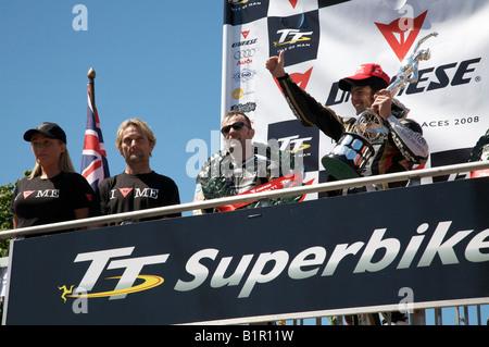 2008 Isle of Man Dainese Superbike Race winner, Australian Cameron Donald, on the podium after receiving the winners - Stock Photo