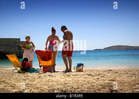 Family standing on the beach, Hondoq Bay, Qala, Gozo, Malta - Stock Photo