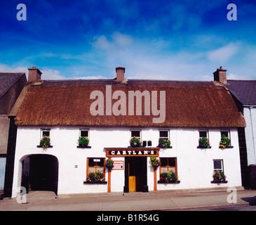 Traditional Thatched Pub, Kingscourt Co Cavan - Stock Photo