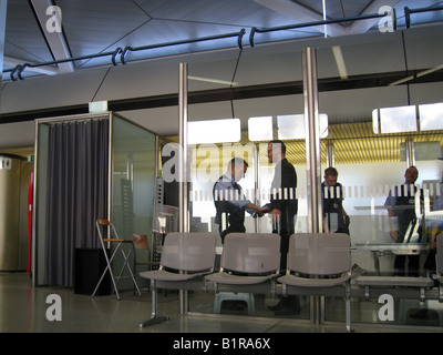 Passengers being checked up in security checkpoint, Berlin International Airport terminal Germany - Stock Photo
