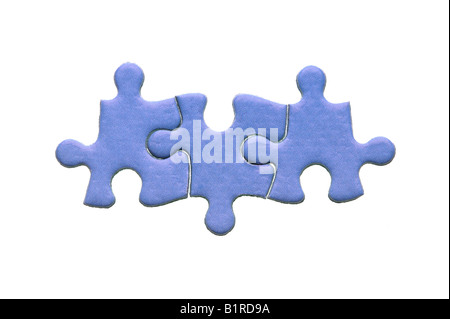Three blue genuine jigsaw puzzle pieces isolated on a white background - Stock Photo