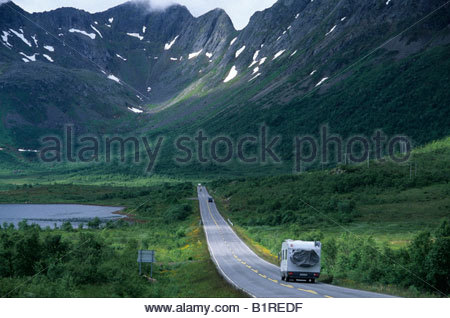 RV trailer driving along the international E-road 10 west of Svolvaer, Austvagoy Island, Lofoten, Norway, Scandinavia, - Stock Photo