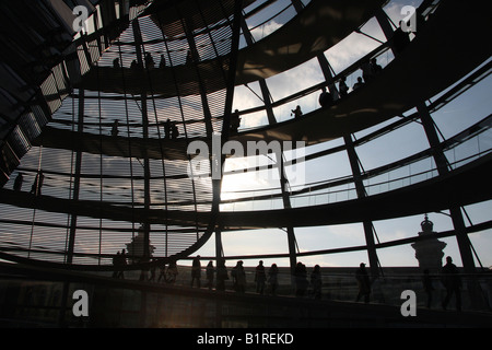 Glass Reichstag Dome or German Parliament Building at dusk in Berlin, Germany, Europe - Stock Photo