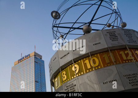 World time clock and Park Inn Hotel on Alexanderplatz Square, Berlin-Mitte, Germany, Europe - Stock Photo