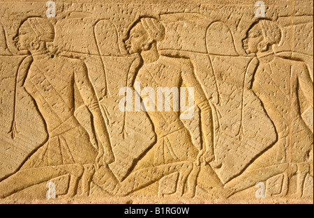Stone wall relief on the Great Temple of Ramses II, Abu Simbel, Egypt, Africa - Stock Photo