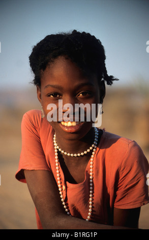 Young girl wearing a pearl necklace, near Sesfontein, Damaraland, Namibia, Africa - Stock Photo