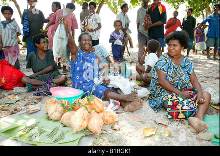 Women selling vegetables and fish at a market, Heldsbach, Papua New Guinea, Melanesia - Stock Photo