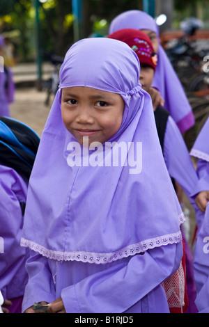 Muslim schoolchildren in front of a school in Mataram, the capital of Lombok Island, Lesser Sunda Islands, Indonesia, - Stock Photo