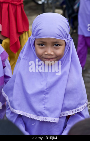 Young Muslim girl dressed in traditional school clothing at a school in Mataram, Lombok Island, Lesser Sunda Islands, - Stock Photo